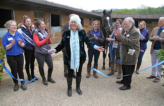 Jilly Cooper Racehorse Sanctuary with flowers